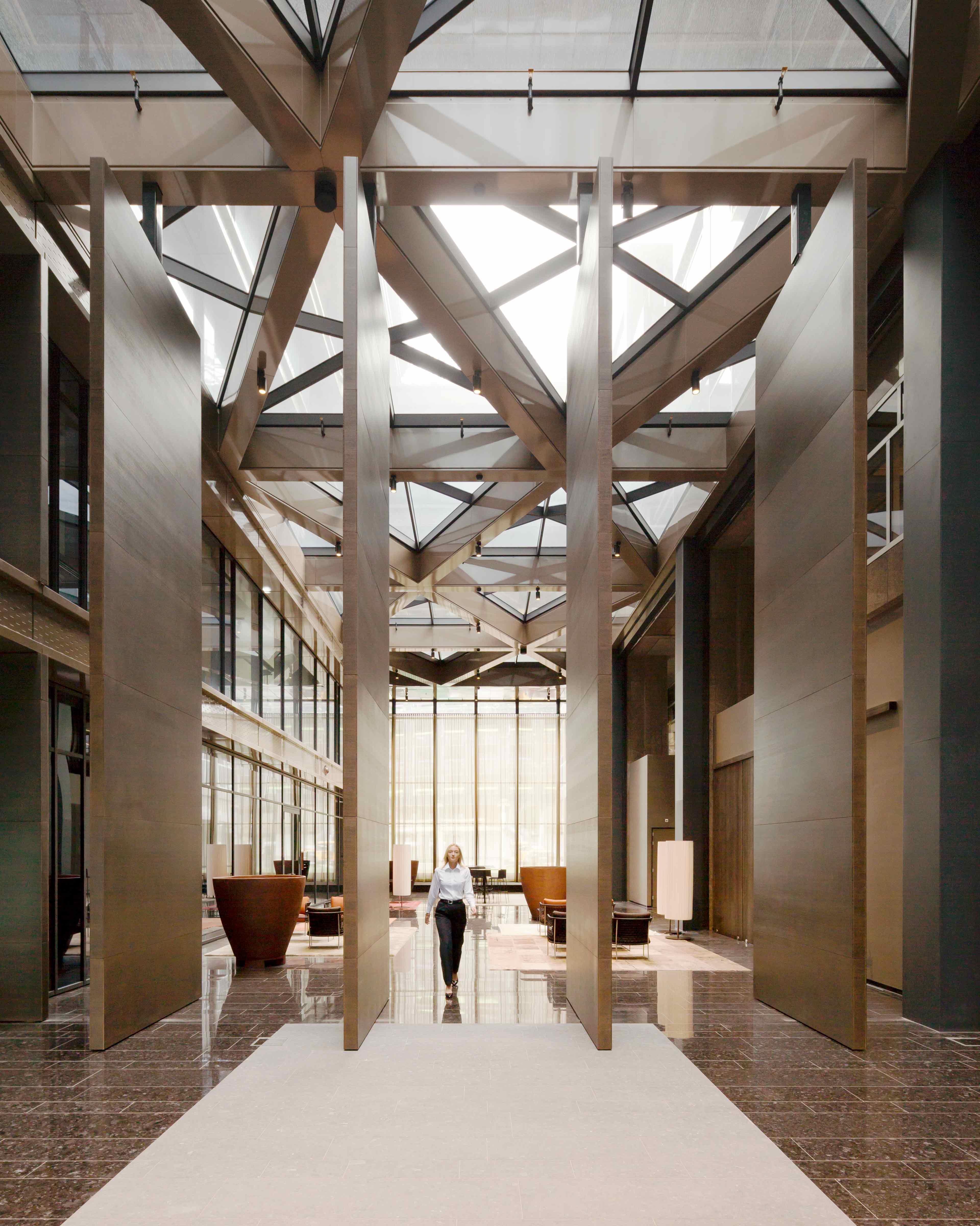Seven meters tall and 500 kg each – massive pivot doors in the Atrium in Amsterdam. Design by MVSA Architecten, built by Harryvan Interieurbouw. FritsJurgens System 3 pivot hinge.