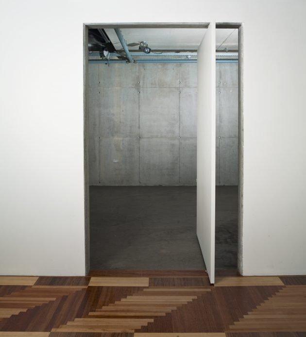 pivot-doors-opened-door-creates-contrast-fritsjurgens.jpg