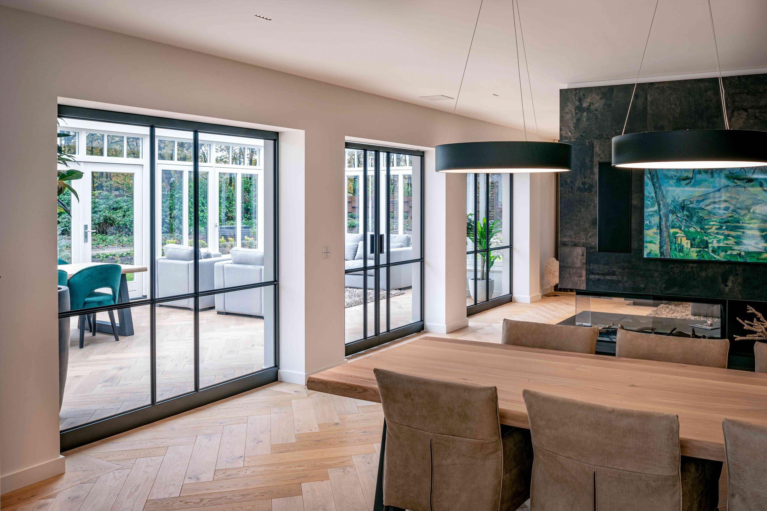 2591-multiple-glass-and-steel-pivot-doors-designed-by-preferro-fritsjurgens-pivot-hinges-inside-scaled.jpg