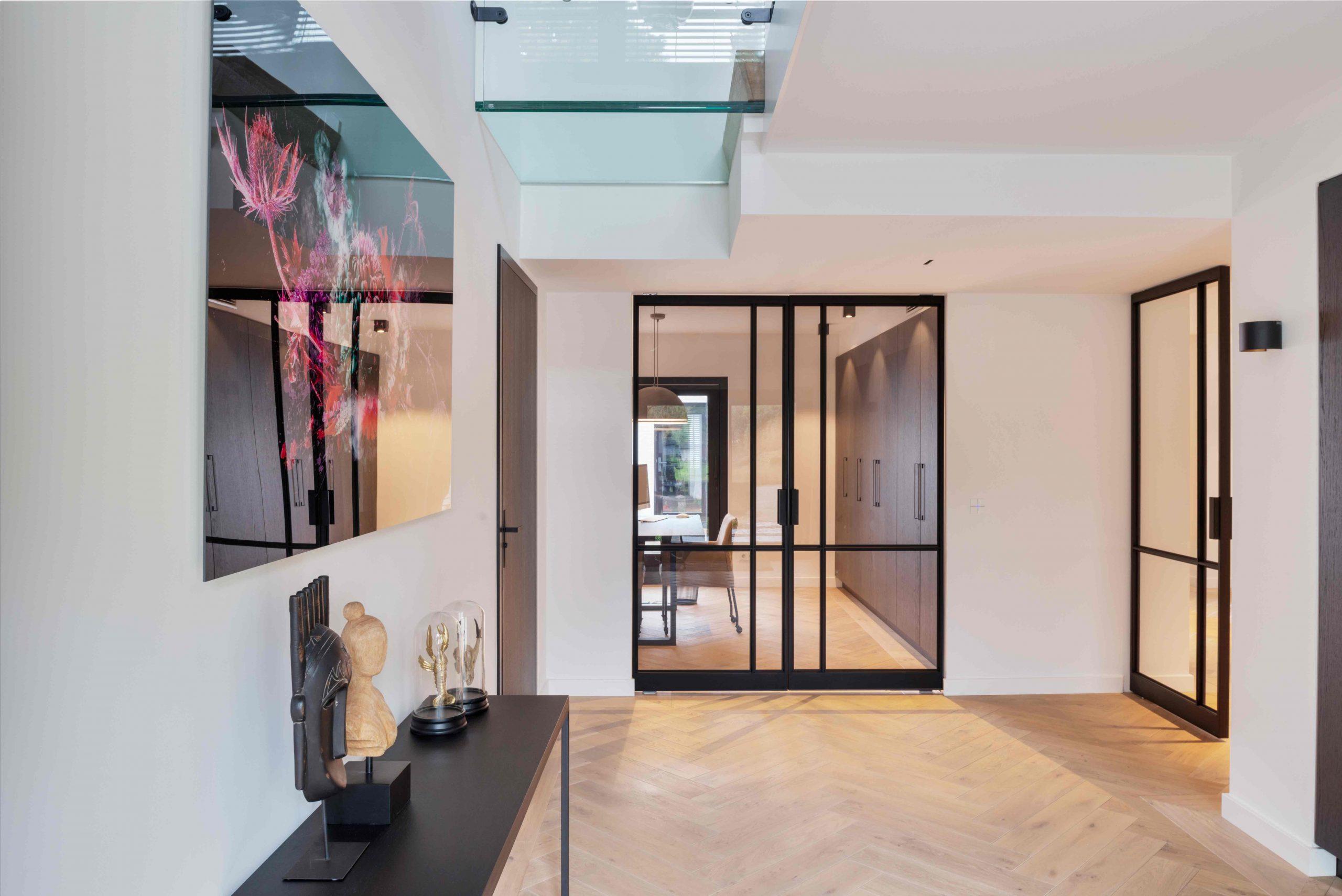 2598-multiple-glass-and-steel-pivot-doors-designed-by-preferro-fritsjurgens-pivot-hinges-inside-scaled.jpg