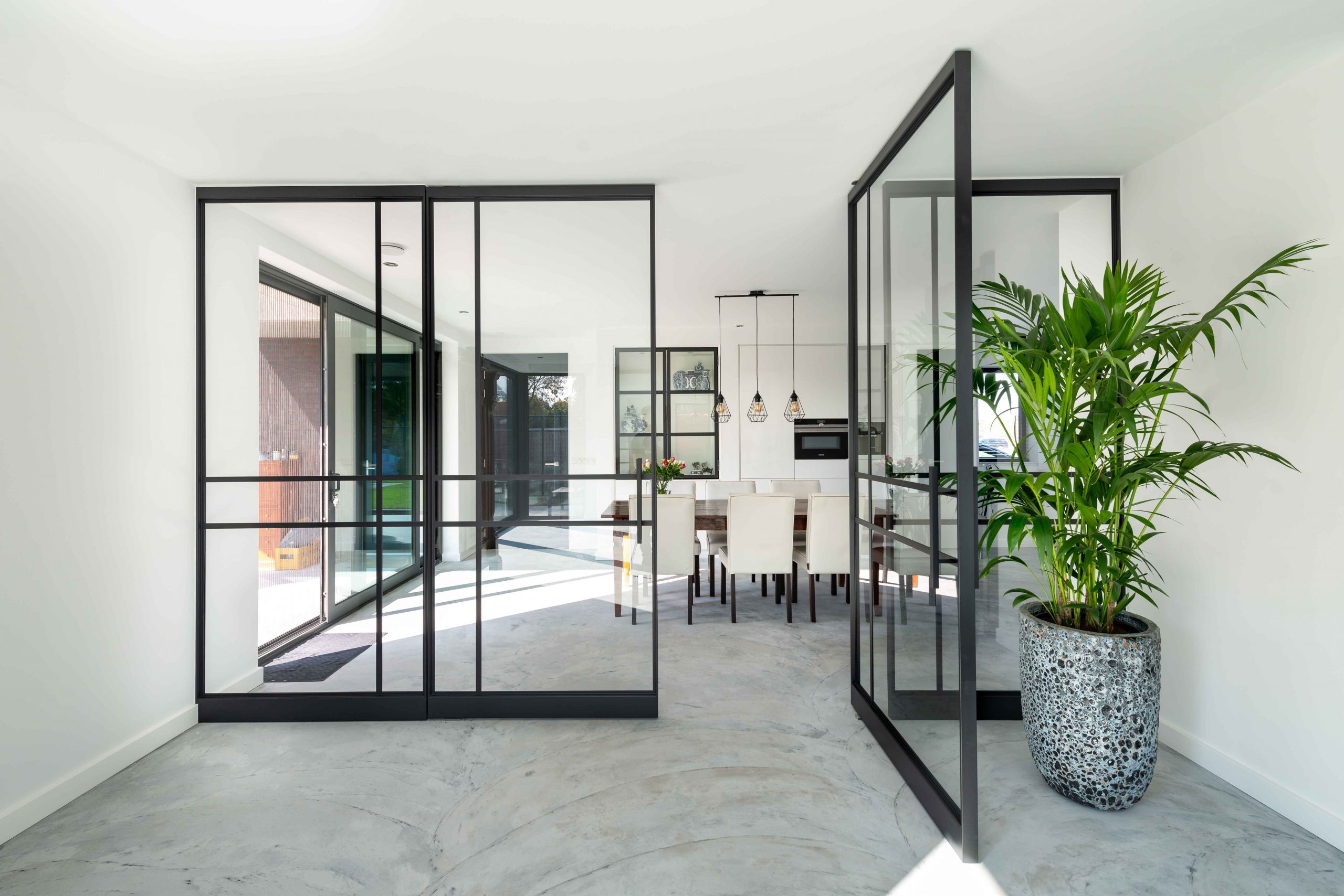 large-glass-pivot-doors-with-a-steel-framework-2-scaled.jpg