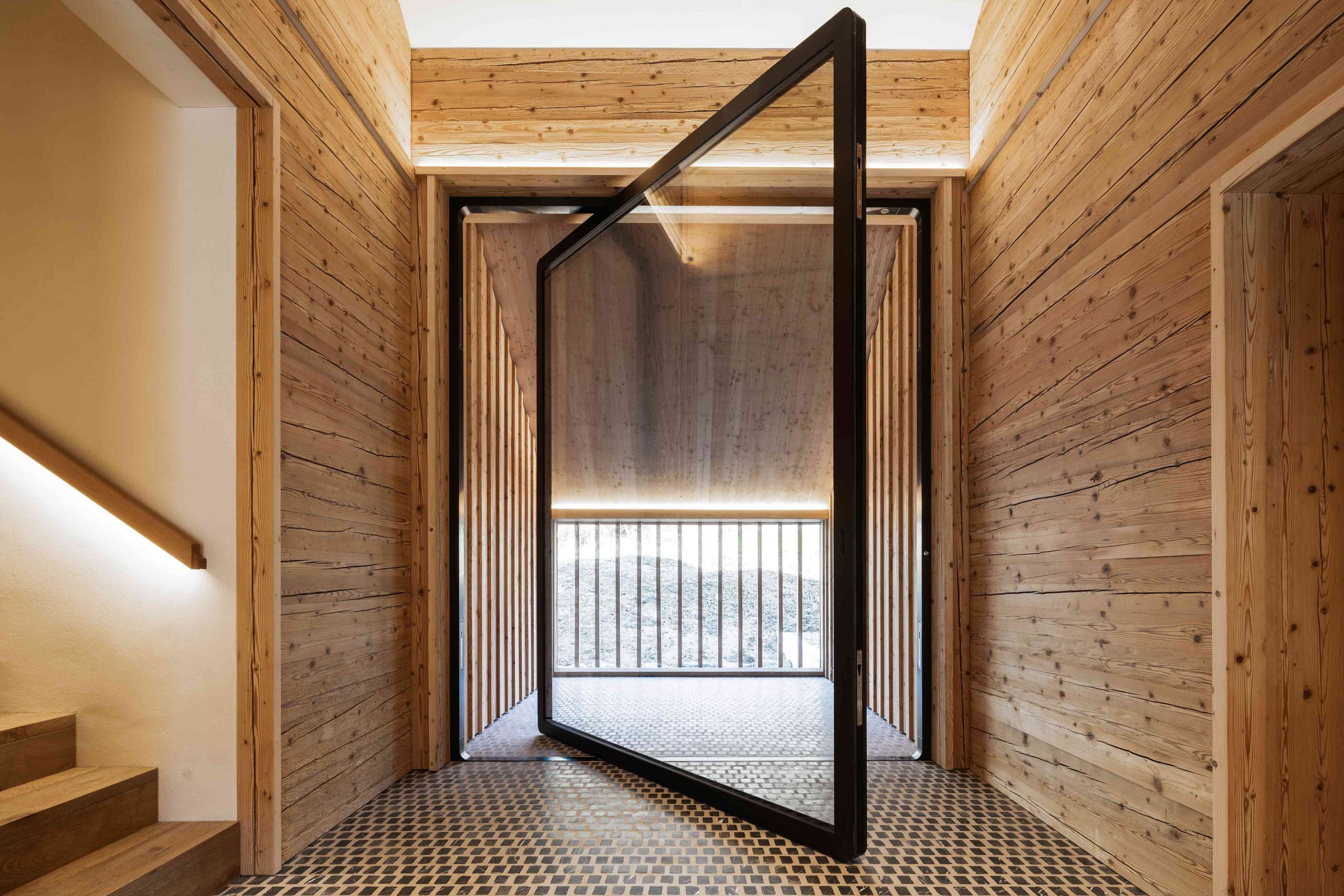 2674-balcony-pivot-door-designed-by-air-lux-1-scaled.jpg