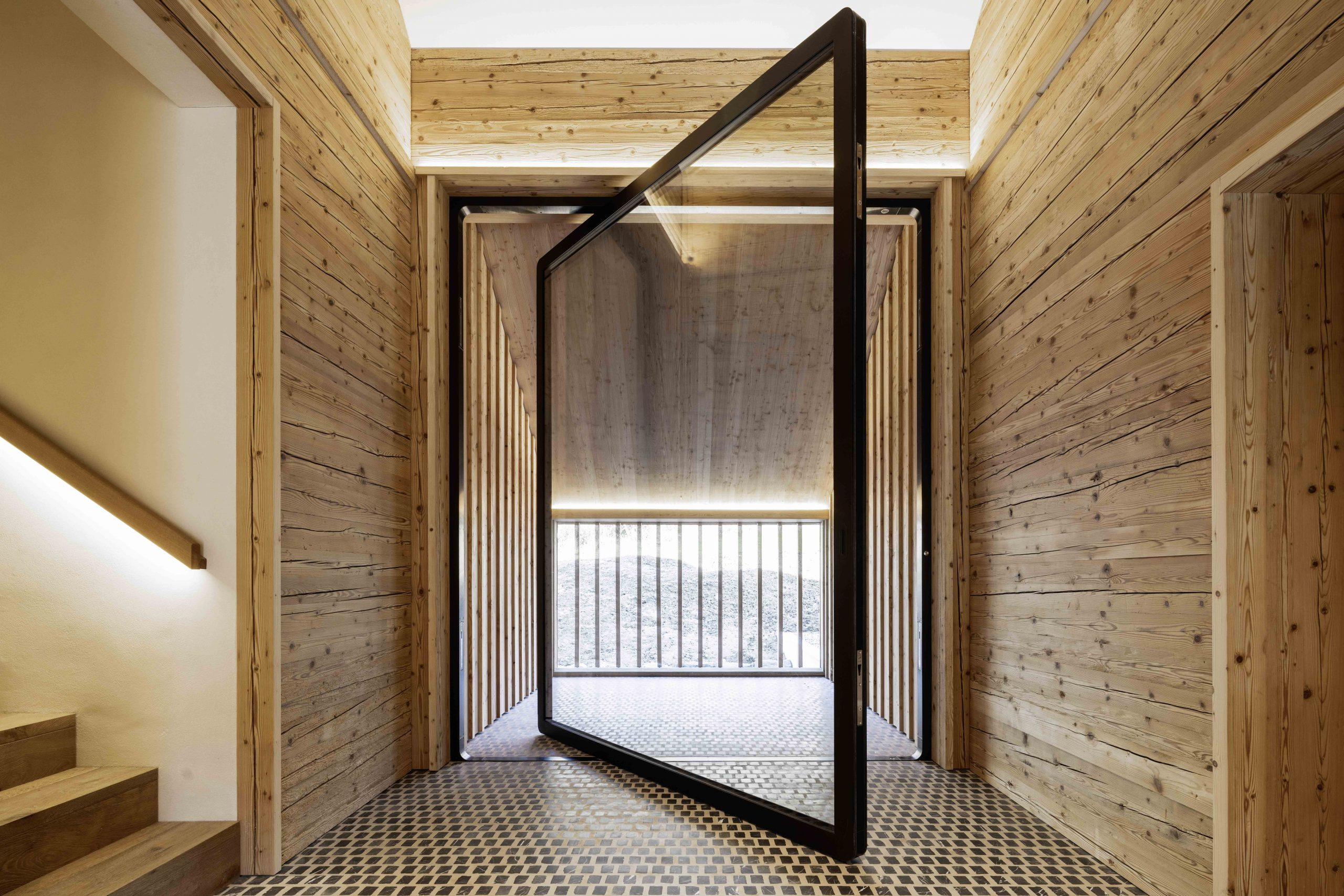 2674-balcony-pivot-door-designed-by-air-lux-scaled.jpg