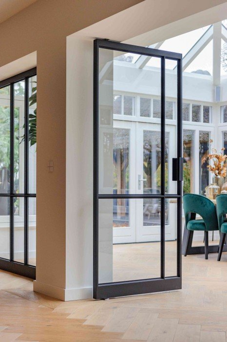 Multiple glass and steel pivot doors designed by Preferro - FritsJurgens pivot hinges Inside